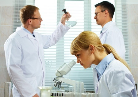 12381083 - team of scientists analyzing different substances at the laboratory